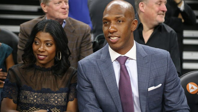 Pistons legend Chauncey Billups and his wife, Piper, watch at the Palace.