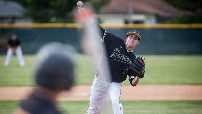 Daleville's Brandon Vermillion pitches against Cowan during their sectional game at Daleville High School Thursday, May 26, 2016.