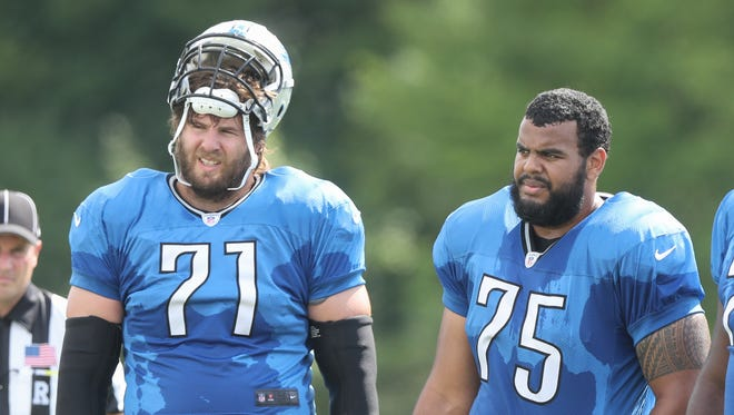 Lions offensive lineman Riley Reiff and Larry Warford.