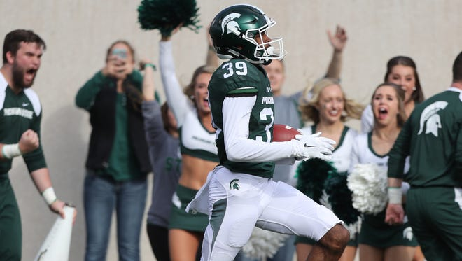 Michigan State defensive back Justin Layne runs back an interception for a touchdown Saurday.