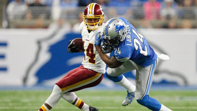 Washington Redskins wide receiver Ryan Grant stiff-arms Detroit Lions cornerback Nevin Lawson (24) during the third quarter Oct. 23, 2016, at Ford Field.