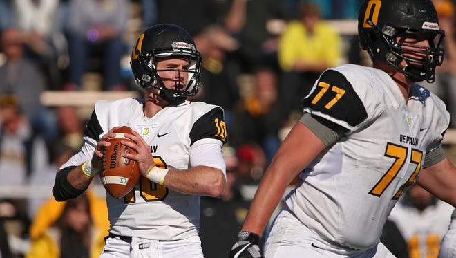 DePauw Tigers quarterback Matt Hunt (10) looks for an open receiver during the 123rd annual Monon Bell Classic between Wabash College and DePauw University at Hollett Little Giant Stadium, Crawfordsville, Ind., Saturday, November 12, 2016.