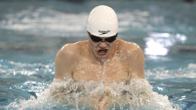 Nicholas Haller of Anderson swims the 100-yard breaststroke at the Division I district swimming finals at Miami University last season.