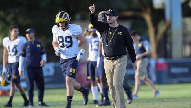 Michigan Wolverines head coach Jim Harbaugh watches drills during practice for the upcoming Orange Bowl against Florida State on Tuesday, December 27, 2016 at Barry University in Miami Shores, Fla.