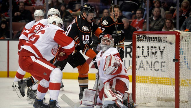 January 4, 2017; Anaheim, CA, USA; Red Wings goalie Petr Mrazek defends the goal as Anaheim Ducks right wing Corey Perry shoots during the second period at Honda Center.