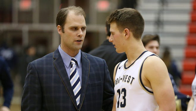 FILE — Tri-West Bruins coach Adam Bontreger talks to guard Tyler Watson, who led all scorers with 28 points Friday against rival Danville.