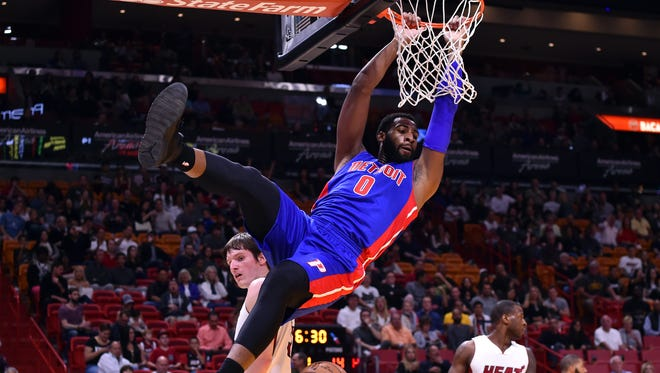 Pistons center Andre Drummond (0) dunks the ball over Heat forward Luke Babbitt (5) during the first half Saturday in Miami.