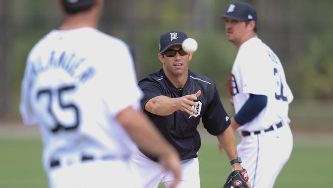 Tigers manager Brad Ausmus works with pitchers on the first day of spring training on Feb. 14 at the remodeled Publix Field at Joker Marchant Stadium in Lakeland, Fla.