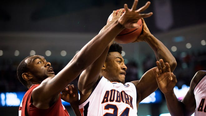 Auburn's Afernee McLemore grabs a rebound over Alabama's Jimmie Taylor (10) during the NCAA Basketball game between Auburn and Alabama on Saturday, Jan. 21, 2017, at Auburn Arena in Auburn, Ala.