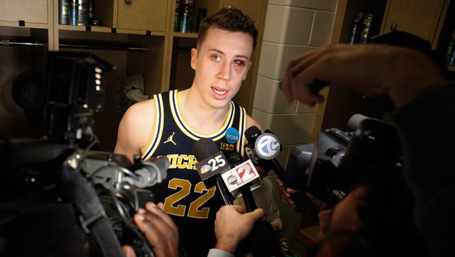 Michigan Wolverines forward Duncan Robinson talks with reporters after the 73-69 win against Louisville on Sunday, March 19 at Bankers Life Fieldhouse in Indianapolis in the second round of the 2017 NCAA tournament.