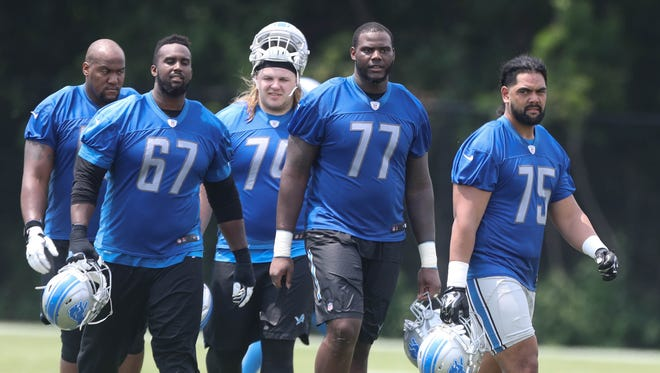 Detroit Lions linemen leave the field after minicamp Wednesday, June 14, 2017 at the practice facility in Allen Park.