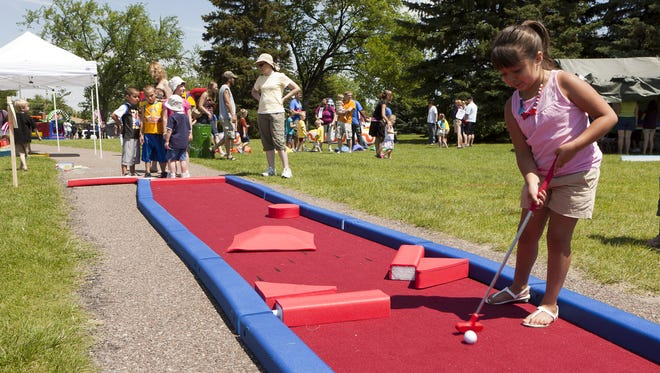 Adriana Amado takes a putt at a previous Lions Family FunFest in Lions Park.