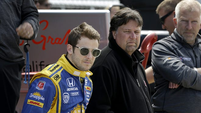 IndyCar driver Marco Andretti sits with his father and team owner Michael, and team COO Rob Edwards during practice for the 100th running of the Indianapolis 500 Monday, May 16, 2016, afternoon at the Indianapolis Motor Speedway.