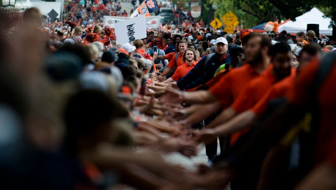Auburn football team greets fans at Tiger Walk before the NCAA football game between Auburn and Mississippi State on Saturday, Sept. 30, 2017 in Auburn, Ala.