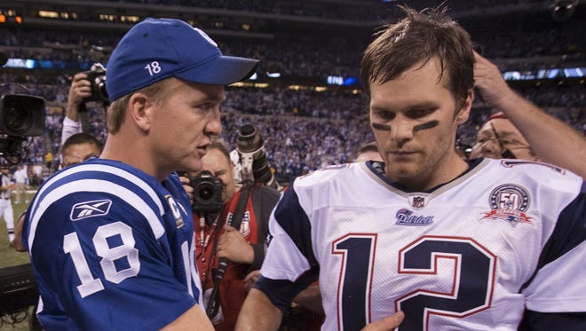 Peyton Manning, of the Colts, pats Tom Brady, his quarterback counterpart, after the Colts won, New England Patriots at Indianapolis Colts, Indianapolis, IN, Sunday, November 15, 2009.  (Robert Scheer/The Indianapolis Star)