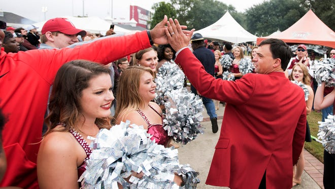 Troy head coach Neal Brown high fives fans during Trojan Walk before the NCAA football game between Troy and Georgia Southern on Saturday, Oct. 28, 2017, in Troy, Ala.