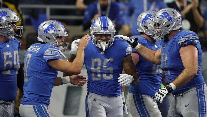 Lions tight end Eric Ebron, center, celebrates his fourth-quarter touchdown during the 38-24 win over the Browns on Sunday at Ford Field.