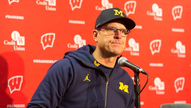 Michigan coach Jim Harbaugh answers questions following the Wolverines' 24-10 loss to undefeated Wisconsin on Saturday, Nov. 18, 2017 in Madison, Wis.