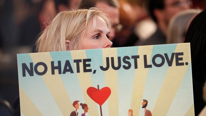 Rita Davis holds a sign during the Hate Crime Law Rally at the Indiana Statehouse. The Central Indiana Alliance Against Hate joined with concerned Hoosiers, business leaders, religious and student groups, and other organizations and hosted a Hate Crime Law Statehouse Rally at the Indiana State House Tuesday, Jan. 16, 2018