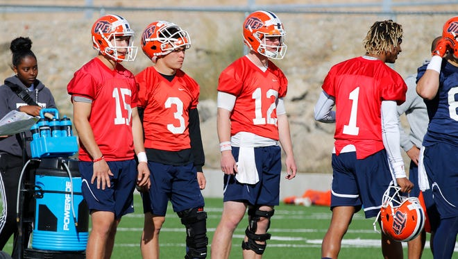 UTEP football opened spring practice Monday with a mixture of former and new quarterbacks jocking for position, they include (l-r) Calvin Brownholtz, Mark Torrez, Ryan Metz and Kai Locksley. The Miners opened spring ball under new head coach Dana Dimel and an entire new coaching staff.