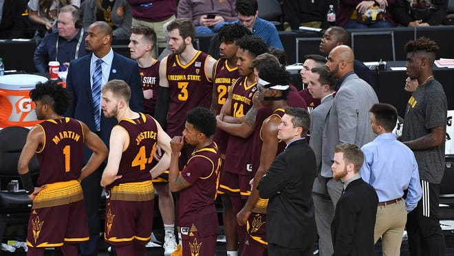 Arizona State Sun Devils players await word from the officials after a scuffle broke between Sun Devils players and Colorado Buffaloes players near the end of the first game of the Pac-12 Tournament at T-Mobile Arena.