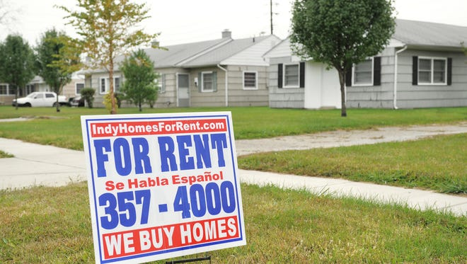 "Frequent ""For Rent"" signs sit in the front yard of several homes in Windsor Village in Indianapolis in 2009."