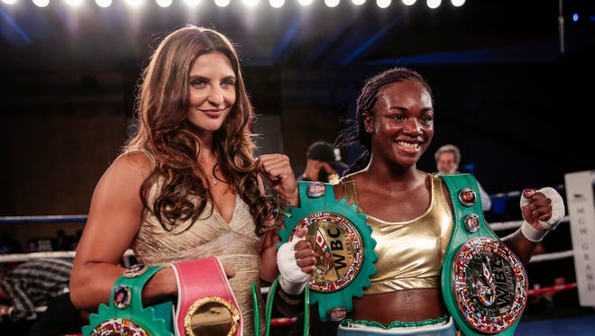 Christian Hammer, WBC Female Middleweight World Champion, left, poses with Claressa Shields at MGM Grand Detroit, August 4, 2017 in Detroit.