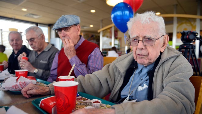 Bill Spahr, who is a member of the Retired Old Men Eating Out club, celebrates his 99th birthday during a club meeting at Wendy's on Friday.
