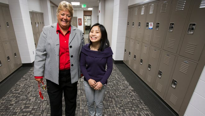 """Southport High School Principal Barbara Brouwer poses with Elly Mawi, a 19-year-old native of Burma who will graduate third in her class. """"I feel like education is the most powerful weapon that I have that I can use to make change in my community for my people and for others,"""" Mawi said."""