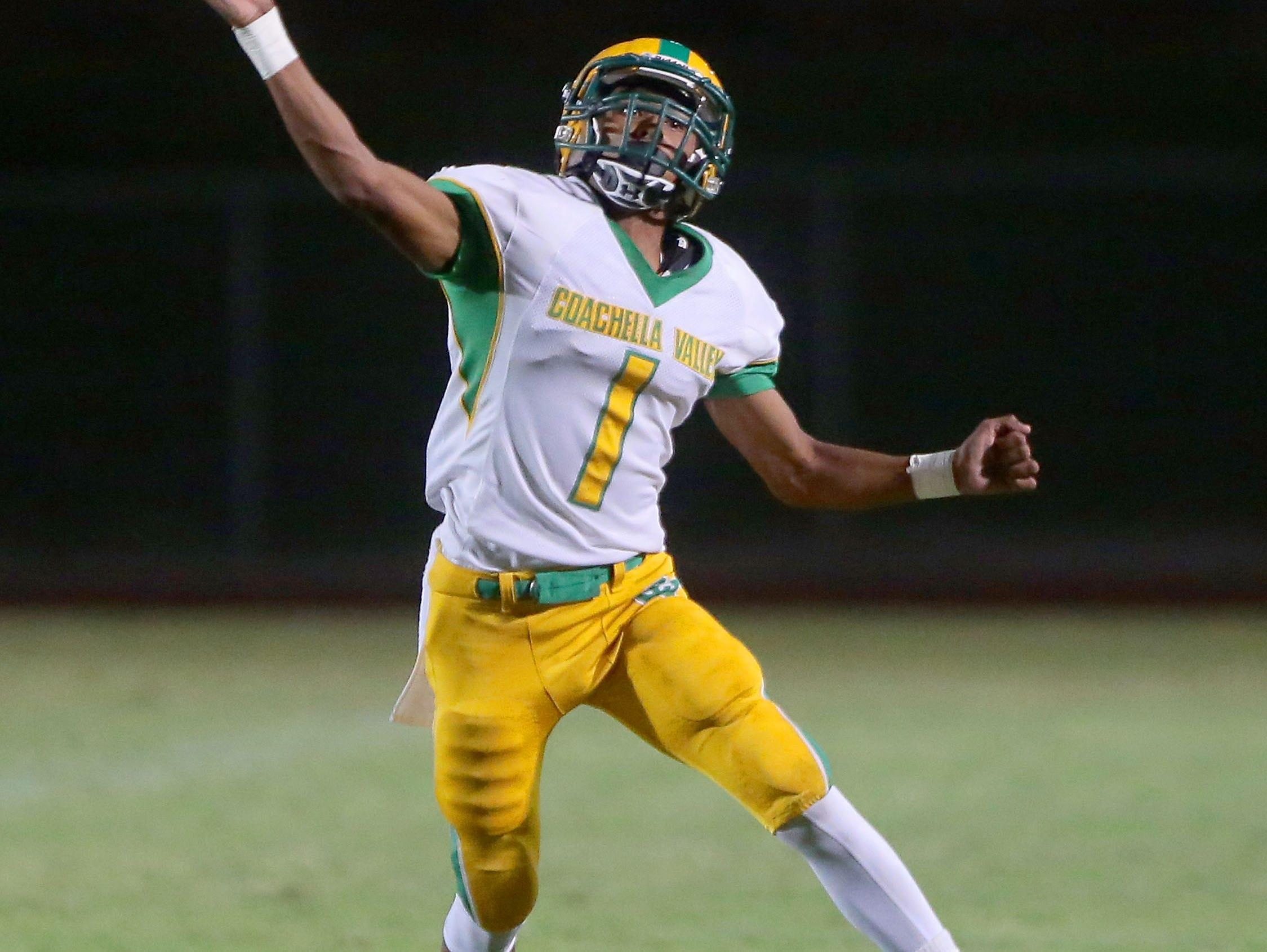 Coachella Valley quarterback Armando Deniz throws against Cathedral City, August 26, 2016.