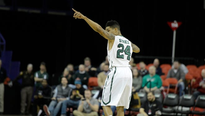 UW-Green Bay's Keifer Sykes (24) reacts after the Phoenix made a basket in the first half  during Thursday night's Horizon League game against UW-Milwaukee at the Resch Center in Ashwaubenon. Evan Siegle/Press-Gazette Media