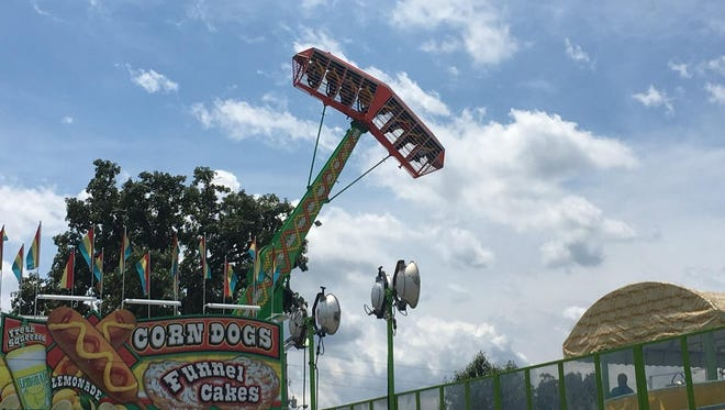 The Screamer is a rip-roaring, pendulum-type ride that leaves people briefly suspended upside down some 75 feet off the ground.