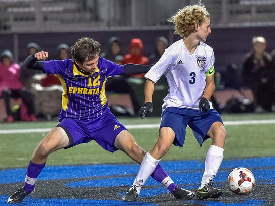 Ephrata's Ellis Vogt (12) tries to steal the ball from