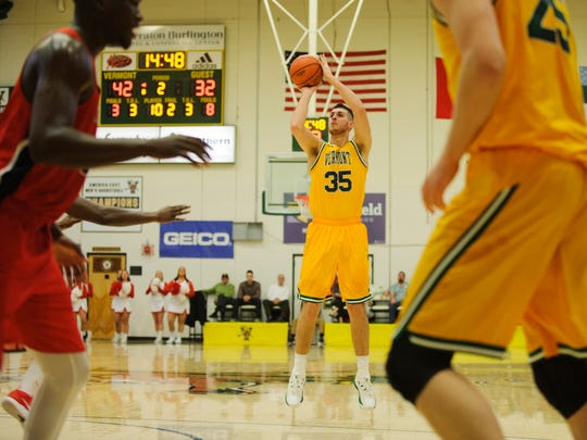 Vermont's Payton Henson (35) shoots a 3-pointer during the America East men's basketball semifinal game between the Stony Brook Seawolves and the Vermont Catamounts at Patrick Gym on Tuesday night