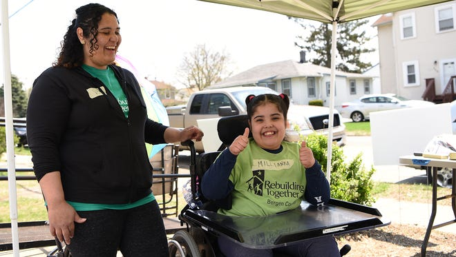 Rebuilding Together North Jersey helps Virgen Rosario (left), a single mother of three children from Pompton Lakes, update her home so that it is wheelchair accessible for her daughter Millianna Rodriguez, 10 years old (right). Shown on Saturday April 28, 2018.