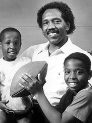 Jerry Moses, shown here with his sons Milan and J.J. in 1989, was one of the nation's top football players in the late 1960s.