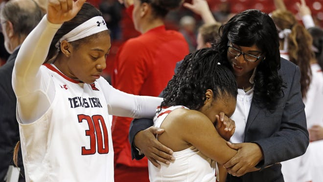 Texas Tech assistant coach Nikita Lowry Dawkins holds Chrislyn Carr (4) after she missed a potential game-winning shot after a Big 12 Conference game Feb. 26, 2019 against Iowa State at United Supermarkets Arena.