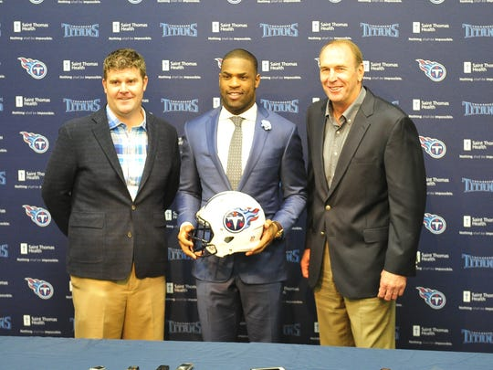 Titans GM Jon Robinson, left, running back DeMarco Murray, center, and Titans coach Mike Mularkey pose for photos during a press conference March 10.