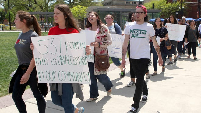 Rothenberg Preparatory Academy and Miami University student teachers march against poverty, violence, homelessness and injustice near Washington Park in Over-the-Rhine on Saturday.