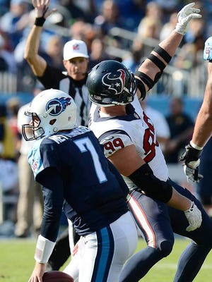 Texans defensive end J.J. Watt pretends to take a selfie after sacking Titans quarterback Zach Mettenberger in the fourth quarter.