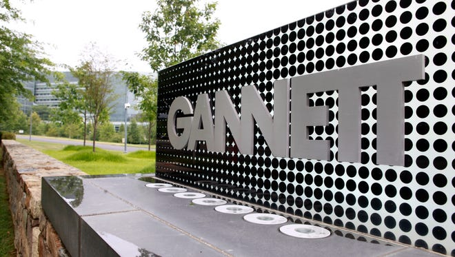 FILE - In this July 14, 2010 file photo, the sign for Gannett headquarters is displayed in McLean, Va. Gannett said Thursday, June 13, 2013, it reached a deal to buy TV station owner Belo for about $1.5 billion in cash, significantly boosting its presence in broadcasting. (AP Photo/Jacquelyn Martin, file) ORG XMIT: NYBZ123