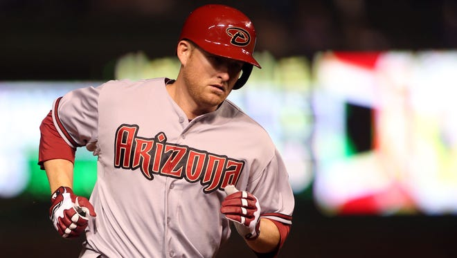 Arizona Diamondbacks left fielder Mark Trumbo rounds the bases after hitting a home run against the Chicago Cubs during on April 21, 2014, at Wrigley Field.