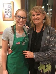 U.S. Army veteran Nicole Cogswell with friend Bonnie McNeil at Starbucks in Fort Myers. Despite being denied disability from the U.S. Department of Veteran Affairs, Cogswell proudly wore an American flag patch and her veteran status on her work apron. Cogswell was medically and honorably discharged in 2015.