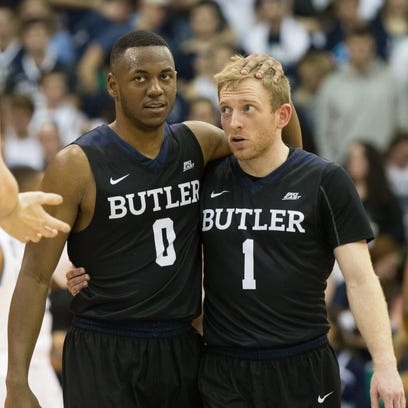 Bulldogs guard Avery Woodson (0) and guard Tyler Lewis