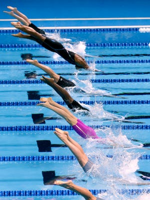 Swimmers dive at the start of heat 17 of the women's 50-meter freestyle preliminaries at the U.S. Olympic swimming trials, in Omaha, Neb., Saturday, July 2, 2016. (AP Photo/Nati Harnik)