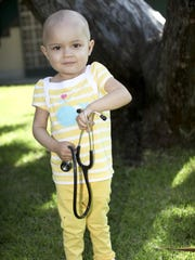 Lyla Hernandez Zavala plays while going through treatment
