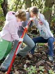 Volunteers, like these young ladies in 2010, are needed this spring to do some work at Rentschler Forest Preserve in Fairfield Township.