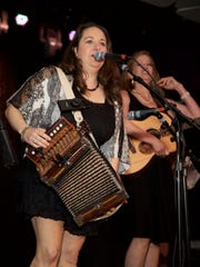Kristi Guillory (left) and Christine Balfa of local band Bonsoir, Catin perform during the Only in Louisiana luncheon at the Conga Room on the eve of the Grammy Awards.