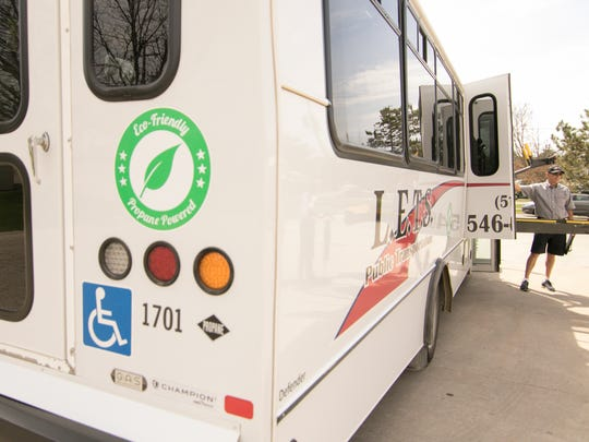 Livingston Essential Transportation Service bus driver Winston Gee stands ready to take passengers home from their workplace at Work Skills Corporation Wednesday, May 2, 2018.
