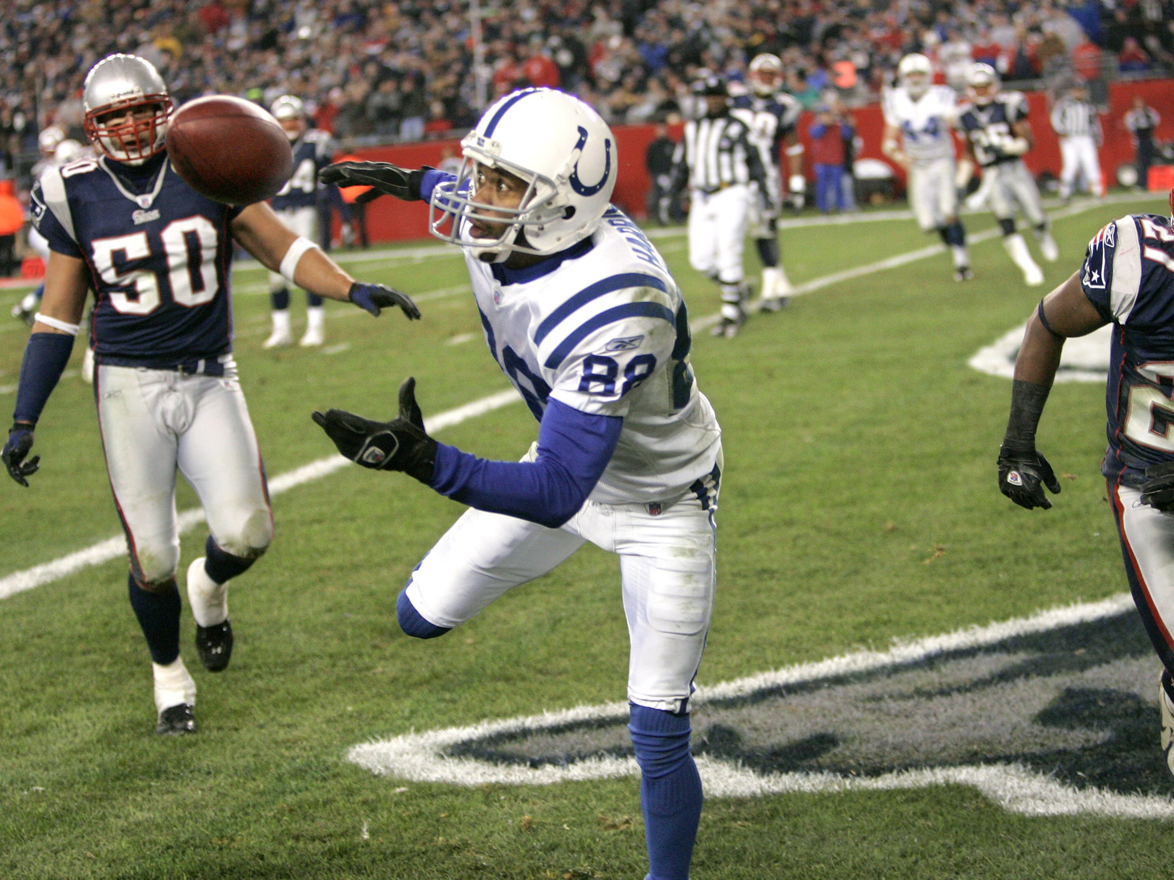 Harrison keeps his eyes on the football before making a spectacular touchdown catch vs. New England in 2006.